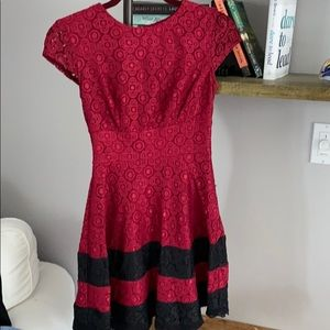 Ruby red party dress with black accent!